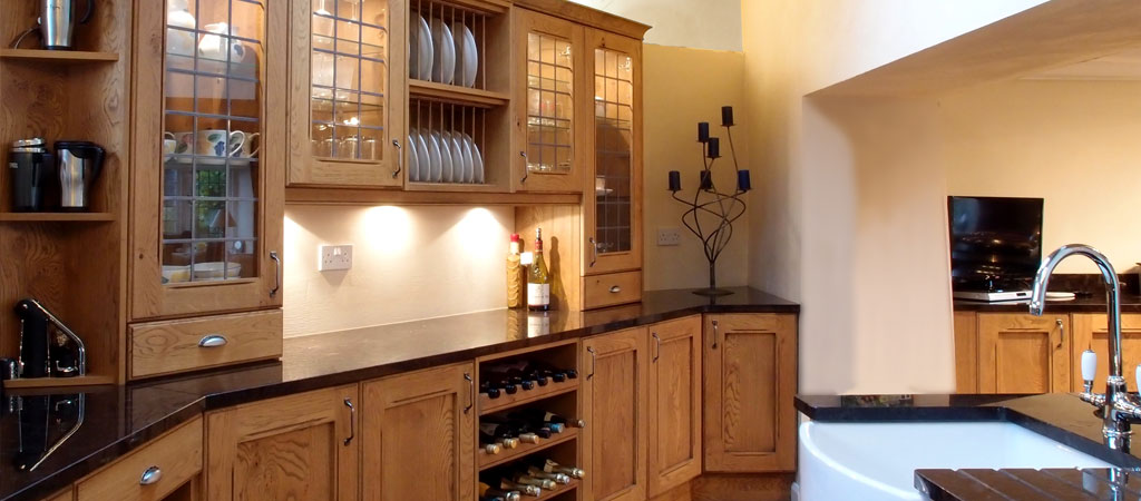 3Ways Whitby - kitchen interior with solid wood units and black granite